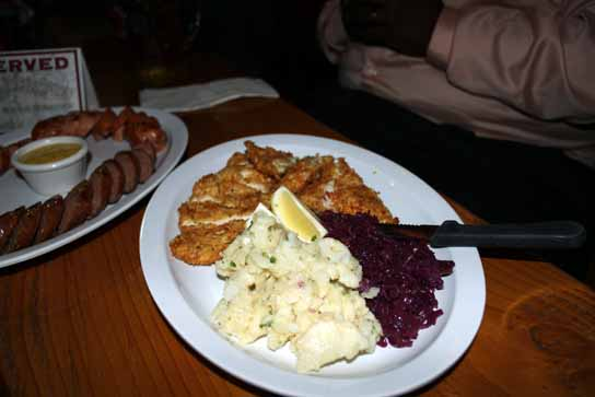 Chicken schnitzel served with German potato salad and stewed red cabbage