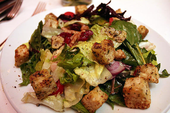 Fleming's signature salad: mixed greens, tomoatoes, onions, croutons, candided walnuts, and cranberries