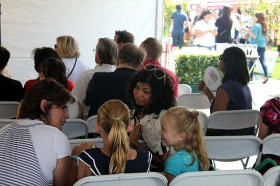 Arti Sequeira gives some attention to a couple of her young fans at THE TASTE 2011.