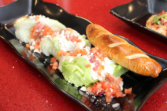 The Wedge Salad with a soft pretzel breadstick ($9.49)